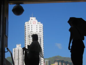 Silhouettes against buildings and sky