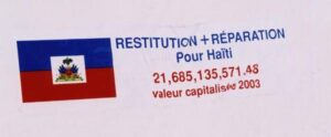 Sticker demanding reparations for Haiti (valued 2003 at 21,685,135,571.48 USD)